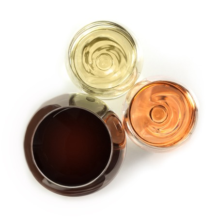 Three glasses of wine on white, overhead photo