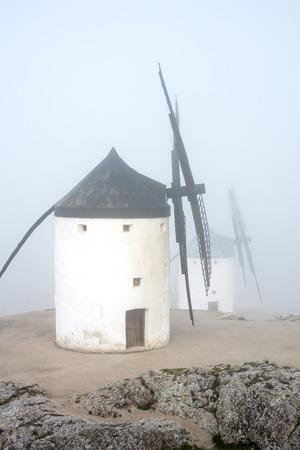 Windmills in thick fog in Castilla-La Mancha, Spain