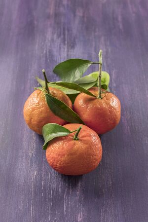 Tangerines on rustic wooden texture with copyspace