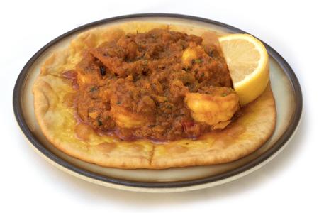 puri: Prawn puri, tyical Indian dish, on white background Stock Photo