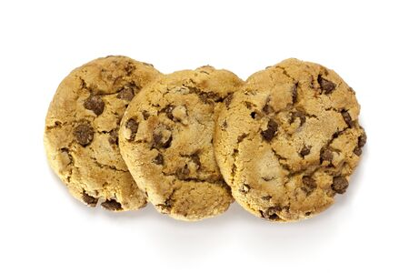 Three crunchy chocolate chips cookies on white