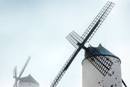 Windmills in a thick fog in Castilla-La Mancha, Spain Stock Photo