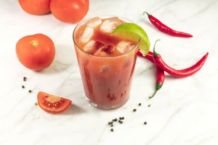 Bloody Mary cocktail with lime, chilis and copyspace