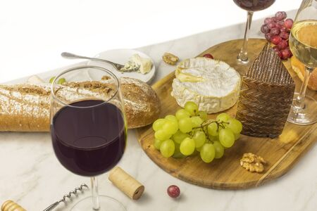 stilton: Wine and cheese tasting with bread, grapes and glass