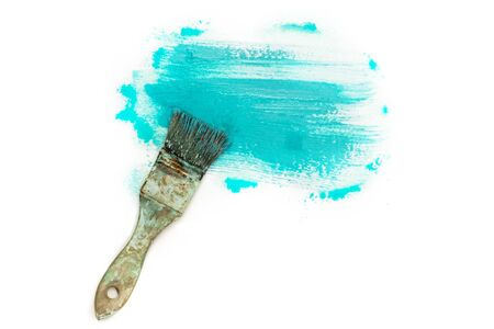 printmaking: Abstract background with teal blue paint strokes and brush Stock Photo