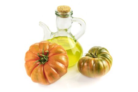 Bottle of olive oil with tomatoes Raf on white