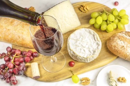stilton: Red wine, cheese, bread and grapes at tasting Stock Photo