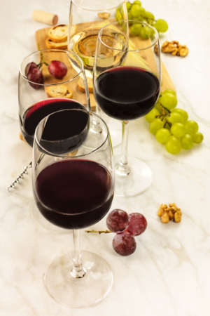 Glasses of red and white wine at tasting