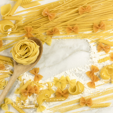 rotini: Various types of pasta on marble with copyspace