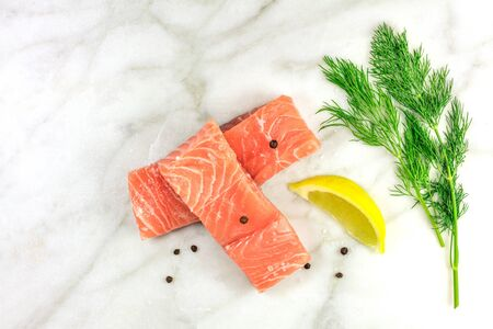 Photo of slices of salmon on white with copyspace Stock Photo