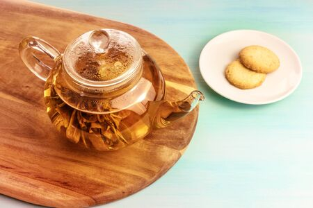 Teapot with tea flower, cookies, and place for text