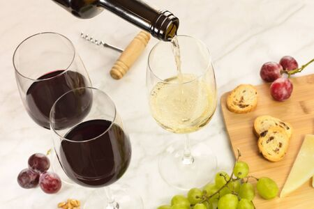 Wine, cheese, bread, and grapes at tasting