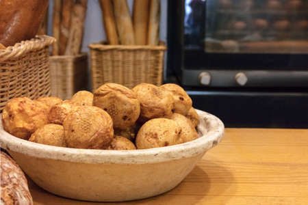 choux bun: Profiteroles in Spanish bakery with oven in blurred background Stock Photo