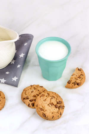 Chocolate chips cookies with milk glass and jar