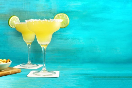 Margarita cocktail photo on vibrant background with copyspace
