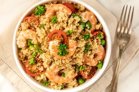 Overhead photo of shrimp and vegetable coucous dish