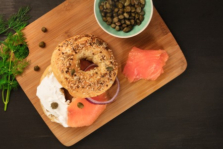 Bagel with cream cheese and lox, and place for text 写真素材