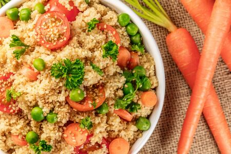 Closeup of vegetable coucous dish with fresh carrots
