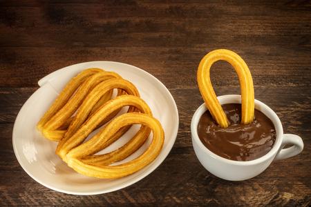 Photo of churros con chocolate, traditional Spanish dessert