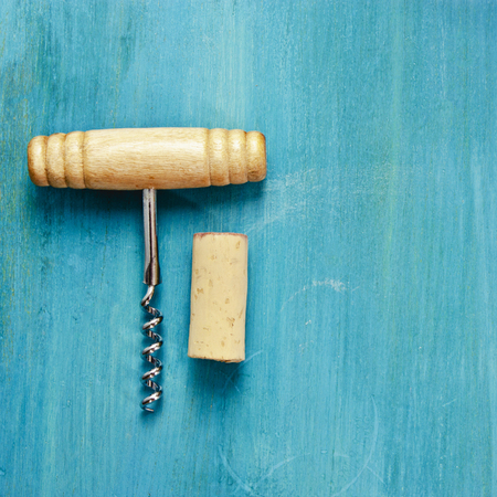 Photo of wine corkscrew and cork on vibrant background Stock Photo