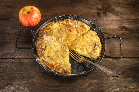 Apple puff pancake pie with apple and copyspace