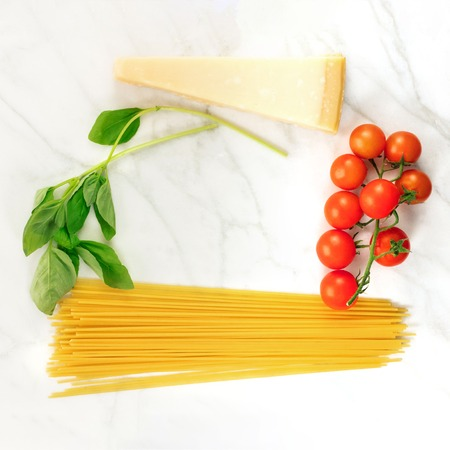 Basic pasta ingredients, including spaghetti and cheese