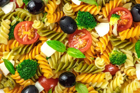 rotini: Closeup of pasta salad with cheese and vegetables