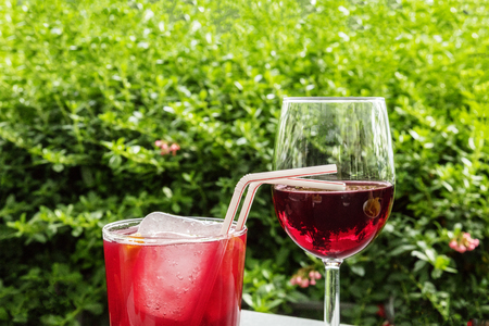 Spanish summer cocktail and red wine on terrace