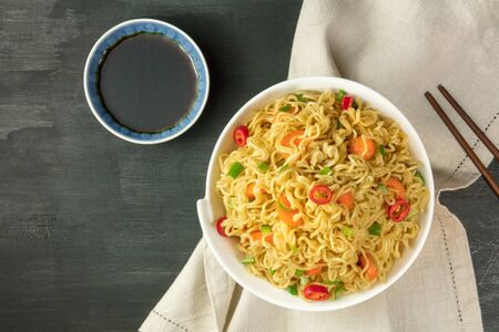 cooked instant noodle: Instant noodles with vegetables, sauce, chopsticks, copy space