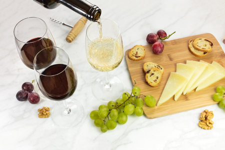 Pouring wine at tasting with cheese, place for text