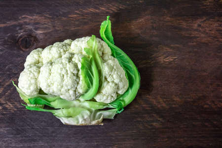 Overhead photo of cauliflower on rustic texture with copyspace