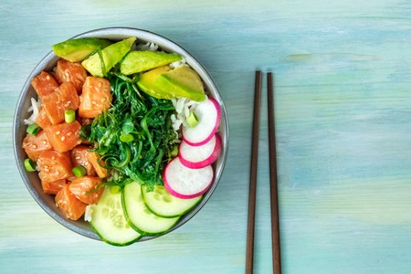 Hawaiian salmon poke salad with wakame and copy space