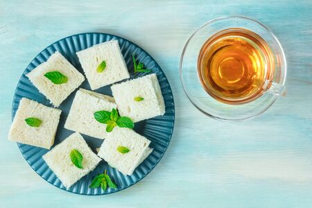 Cucumber sandwiches and tea, shot from above with copy space