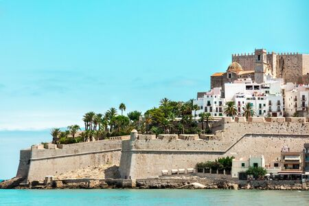 Spanish castle Peniscola, blue sea, teal blue sky Stock Photo