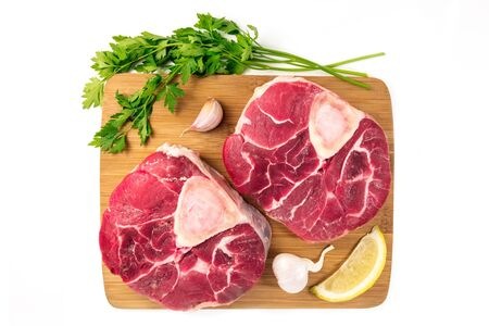 Osso buco and gremolata ingredients on white background