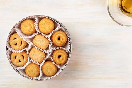 Overhead view of Danish butter cookies with tea and copyspace Foto de archivo