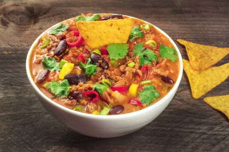 Chili con carne, traditional Mexican dish, with nachos