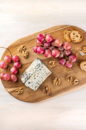 stilton: Blue cheese with grapes, nuts, toasts, and copyspace