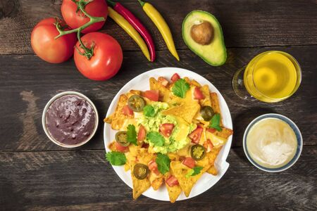 Nachos with cheese, traditional Mexican snack, with ingredients Stock Photo