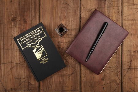 The Murder of Roger Ackroyd, detective novel by Agatha Christie, with leather journal and ink pen