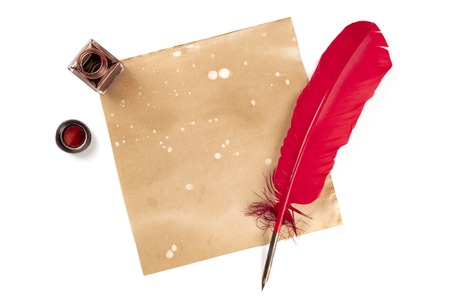 An overhead photo of an ink well with a piece of old paper, with a red quill and copy space, shot from above on a white background