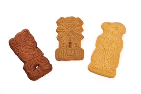 An assortment of traditional Christmas Spekulatius cookies, shot from the top on a white background with copy space
