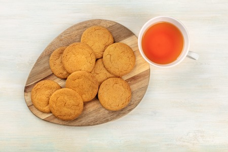 Gingersnaps, shot from above with a cup of tea and a place for text