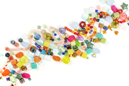 An overhead photo of many different beads, shot from the top on a white background with a place for text 写真素材