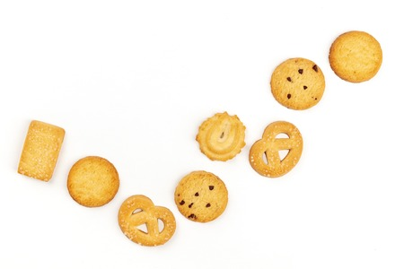 A flat lay composition of Danish butter cookies, shot from the top on a white background with a place for text