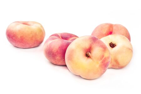 Vibrant organic flat saturn peaches on a white background with a place for text