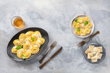 Italian Food banner design. Round and square ravioli, shot from above with a glass of white wine, forming a frame with a place for text