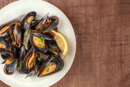 Marinara mussels, moules mariniere, close-up overhead shot on a rustic background