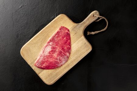 Kobe meat, wagyu beef steak, shot from above on a cutting board Banque d'images