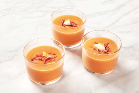 Salmorejo, Spanish cold tomato soup, in glasses on a marble background Reklamní fotografie